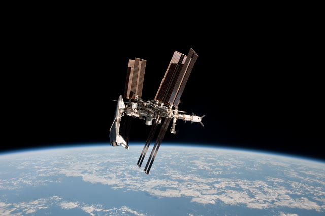 Space Shuttle Endeavour docked to ISS (NASA/Paolo Nespoli)